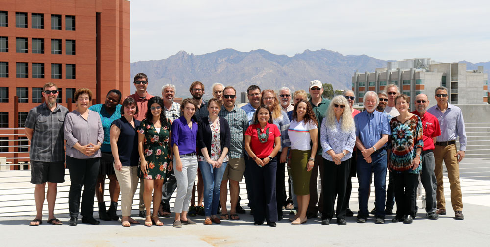 Our faculty and staff gather to discuss environmental challenges