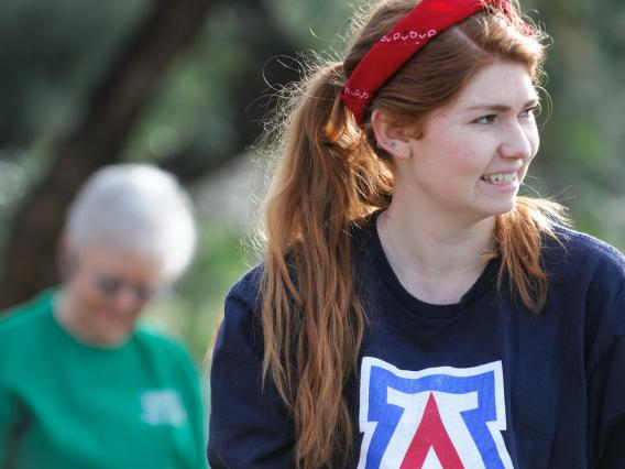 Student helping clean up a local Arizona park