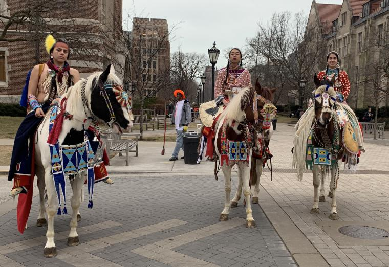 Apsaalooke women participate in a parade at the University of Chicago