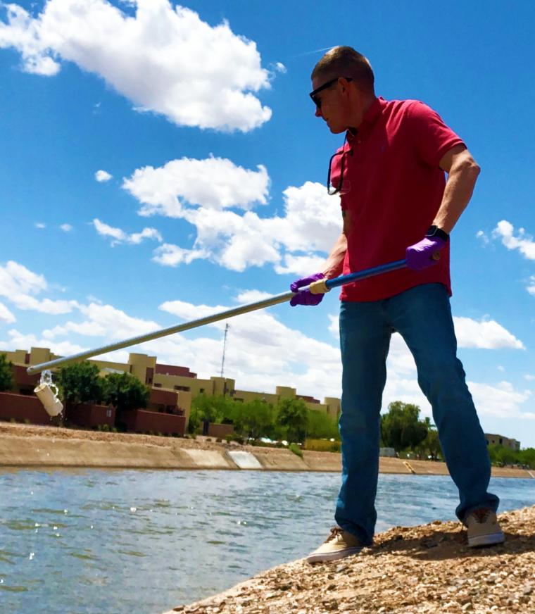 Alumnus Stefan Walston sampling water