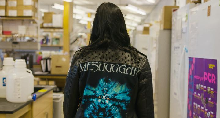 Women in metal jacket walking in lab
